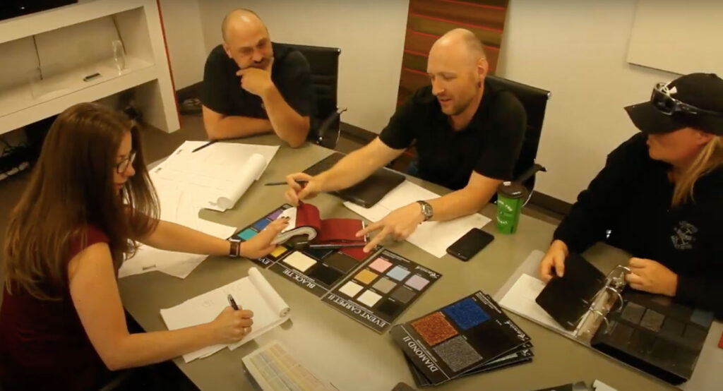 Four colleagues meeting to design an event