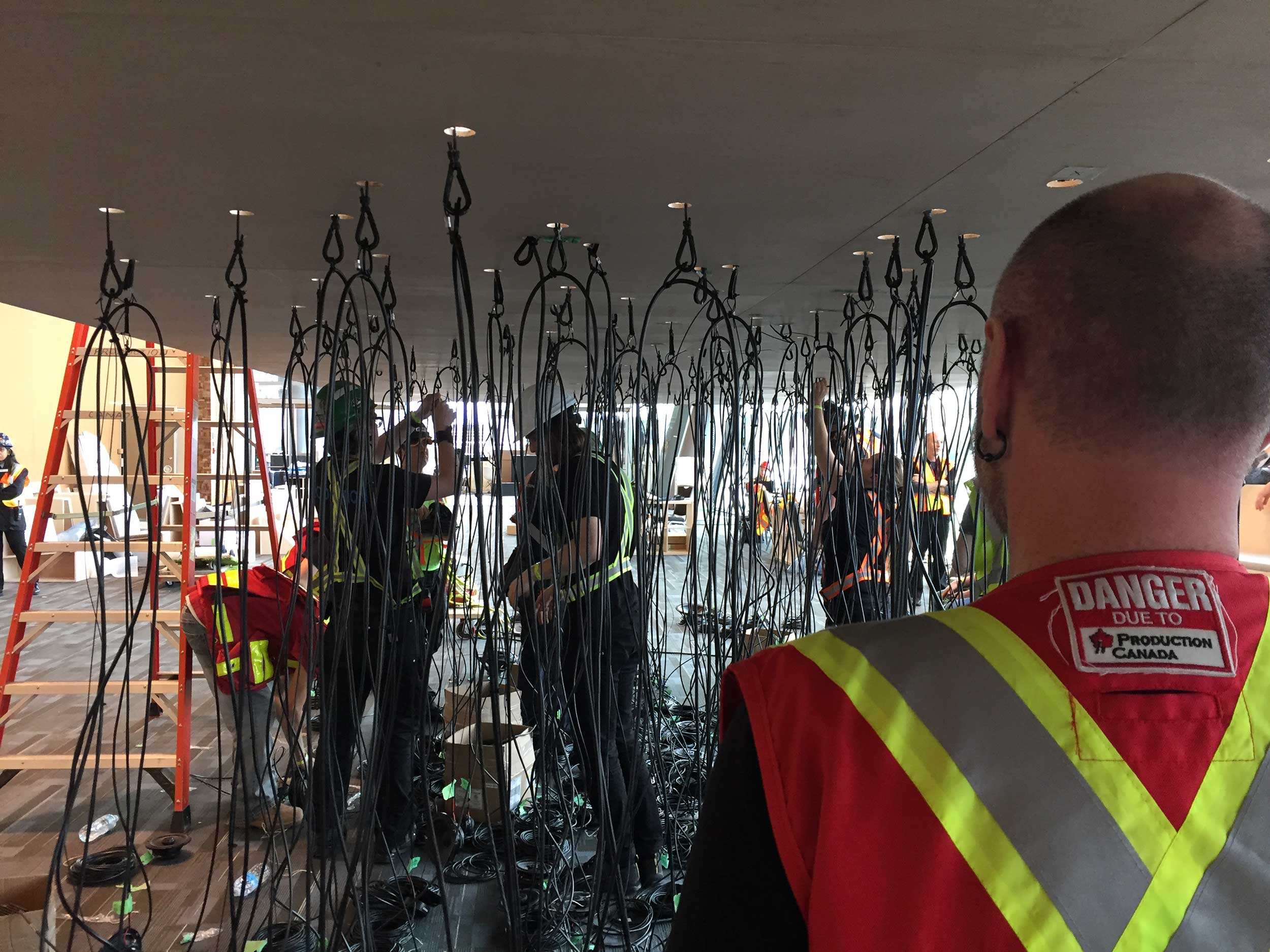 A supervisor looking at an art installation