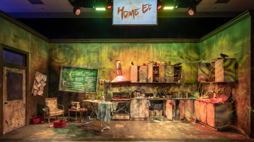 A backdrop designed and built to look like a home ec room in a haunted high school