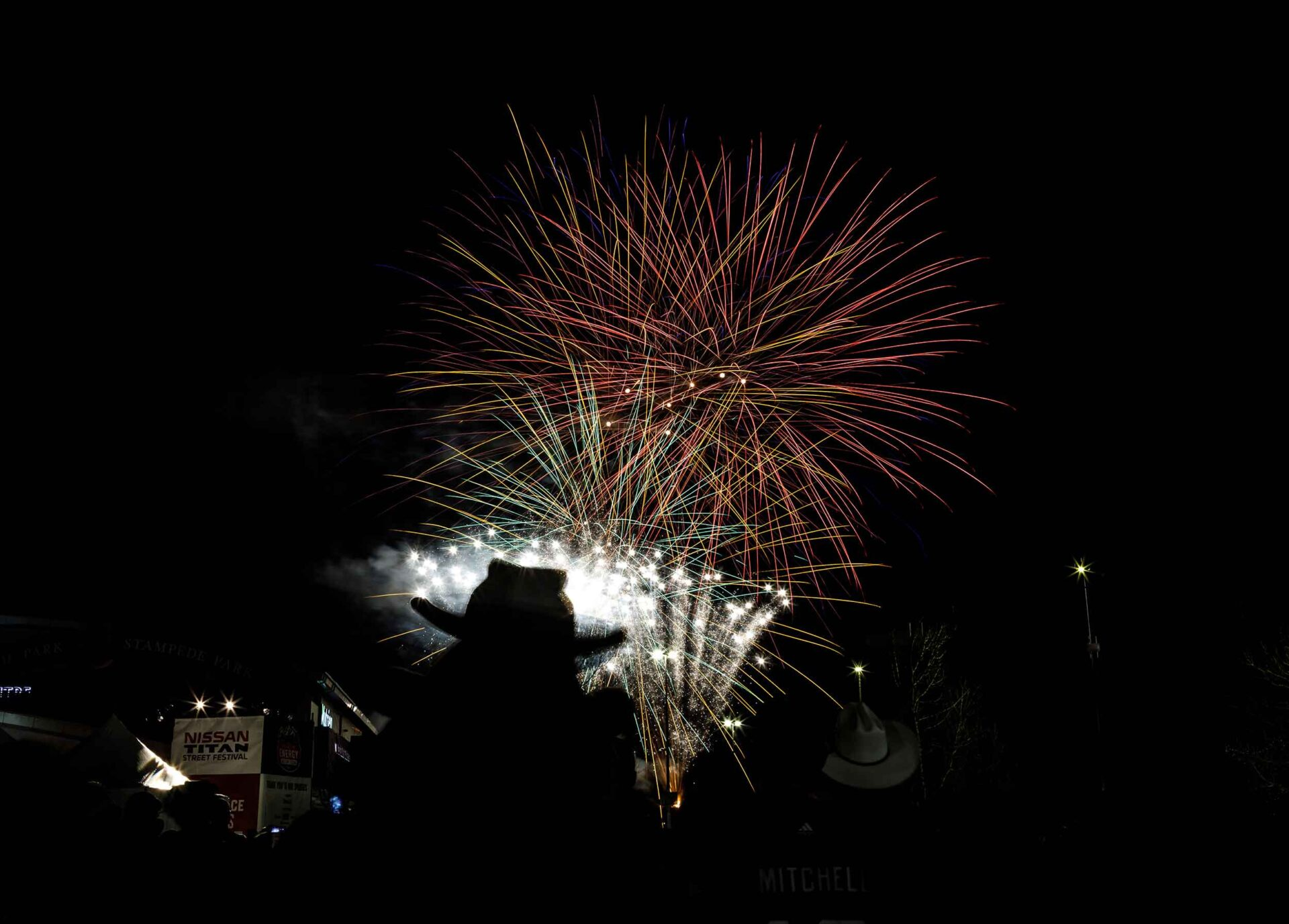 Silhouette of a cowboy hat in front of fireworks at the 2019 Grey Cup Festival