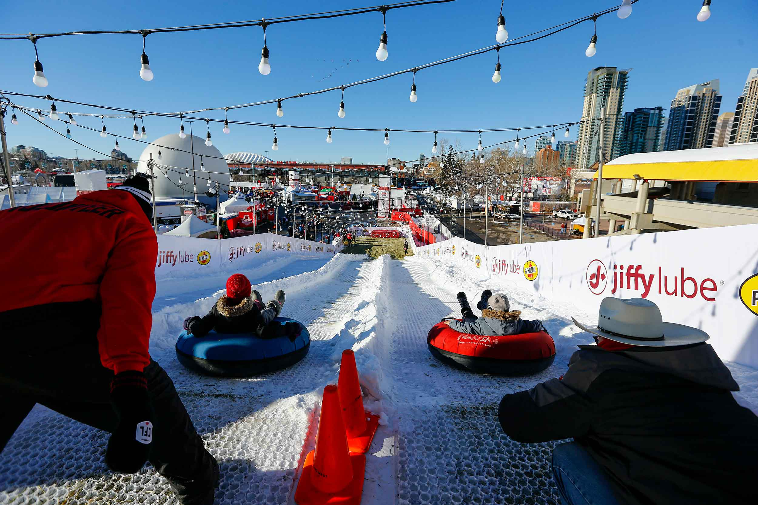 View from the top of a snowy tubing slide at the 2019 Grey Cup Festival