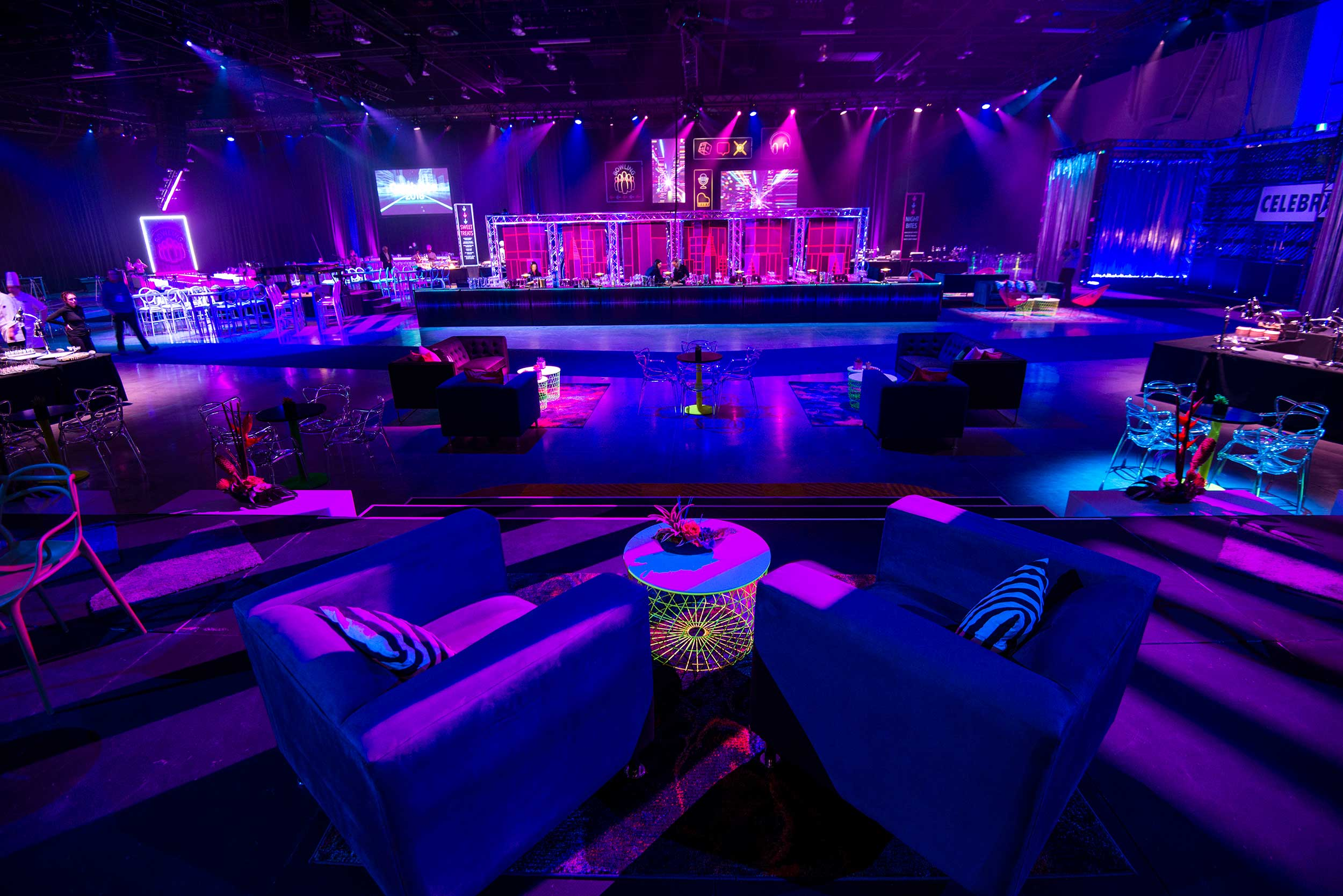 Room shot of a corporate event with neon lighting